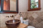 Half bathroom with copper sink