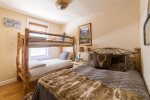 Guest room with a queen and two twin bunks
