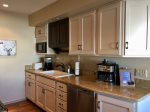Fully stocked kitchen with high end appliances, dishwasher, and gas range
