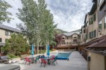 A shared pool, hot tub and grill area you can enjoy during the summer