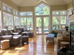 High ceilings and large windows let the light pour into the living area