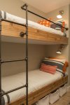 A twin bunk bed, that sleeps 2, is located next to the guest bedroom