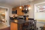 Eat-in kitchen with breakfast bar seating for 2