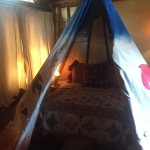 A complete queen-sized bed is available in the tee pee room
