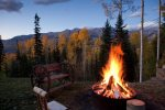 Enjoy the fire pit outside and the towering mountains in the background