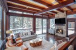 Step down into the living room and relax with a fire and forest views
