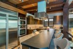 Large chef`s kitchen that overlooks the living room