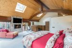Spacious master bedroom complete with king bed, gas fireplace, and huge views