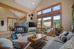 An open floor plan and vaulted ceilings lend a spacious feel to the living area