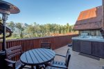 Impressive views from the deck with your own private hot tub, seating, and a BBQ grill