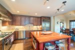 Large kitchen with brand new, high-end appliances, large island with bar seating
