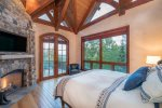 Master suite with fireplace, king bed and high ceilings
