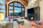 The living room has vaulted ceilings and gorgeous views through expansive windows