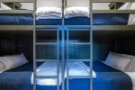 The fourth guest bedroom is a downstairs bunk room with four full-sized beds