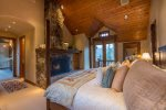 Master Bedroom with king bed, fireplace and private deck