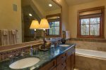 Master bathroom with a soaking tub and steam shower