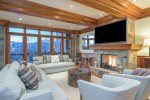 The stately living area offers up big views, cozy seating, and a great fireplace