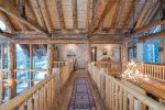 Huge ceilings and gorgeous timbers are featured throughout the home