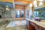 Soaking tub with jets and walk-in steam shower in the master bathroom