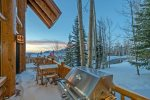 Soak away the day in the hot tub on the edge of an aspen forest