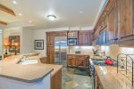 Enjoy wood cabinets and granite counter tops in the fully-equipped kitchen