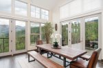 Family style dining area with bench seating serves up a side of big views