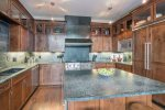 State-of-the-art kitchen with stainless steel appliances and a massive island