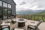 Enjoy the stunning views from the outdoor patio with a fire pit