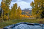 Soak in your private hot tub while enjoying exquisite views