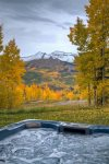 View the majestic mountains from your private hot tub