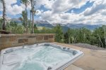 Soak in the large outdoor hot tub while you sip on a beer or glass of wine as the sun sets