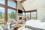 The master suite is bright and warm with huge views that pour in through each window