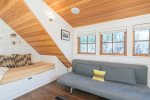 The upstairs loft area has a full-sized futon for additional sleeping arrangements