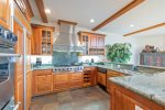 Gorgeous granite countertops and stainless steel appliances in the full-stocked kitchen