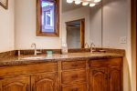 The en suite master bathroom has a double vanity