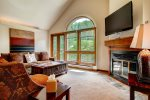 A gas fireplace heats the living area and you have access to a private deck oustide