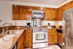 Stainless steel appliances in the fully-equipped kitchen with everything you need