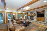 A gas fireplace heats the downstairs family room and you have access to the back deck with private hot tub