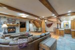 Log cabin luxury includes a downstairs family room with fireplace and a bar area
