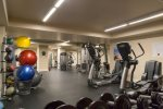 Free weights, ellipticals, machines, and a Peloton bike system are all available for your use