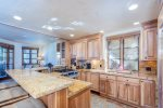 The well-appointed kitchen with granite countertops and stainless steel appliances