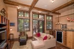 Open-concept living with custom timber ceilings