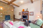 Bear Creek Loft B - Comfortable living area with flat-screen TV, gas fireplace