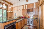 This chef`s kitchen has stainless steel appliances and granite countertops
