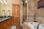 Master bedroom with ensuite bath. Soaking tub and steam shower