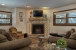 Enjoy the living area with the gas fireplace