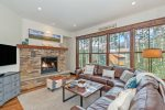 Open concept living space with breathtaking views and a gas fireplace