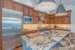 Gorgeous marble countertops and an island with breakfast bar seating for 3