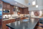A large kitchen island provides plenty of space for prep