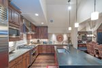High-end appliances and a fully-equipped kitchen